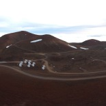 View of the Submillimeter Valley from the Subaru Catwalk. The SMA (SubMillimeter Array is visible). Also the James Clerk Maxwell Telescope (JCMT; white building with flat roof) and now defunct Caltech Submillimeter Observatory (CSO) (silver dome)